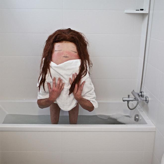 Creepy creature standing in a bath.