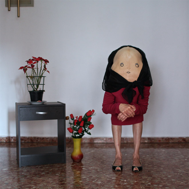 Creepy lady posing with flowers.