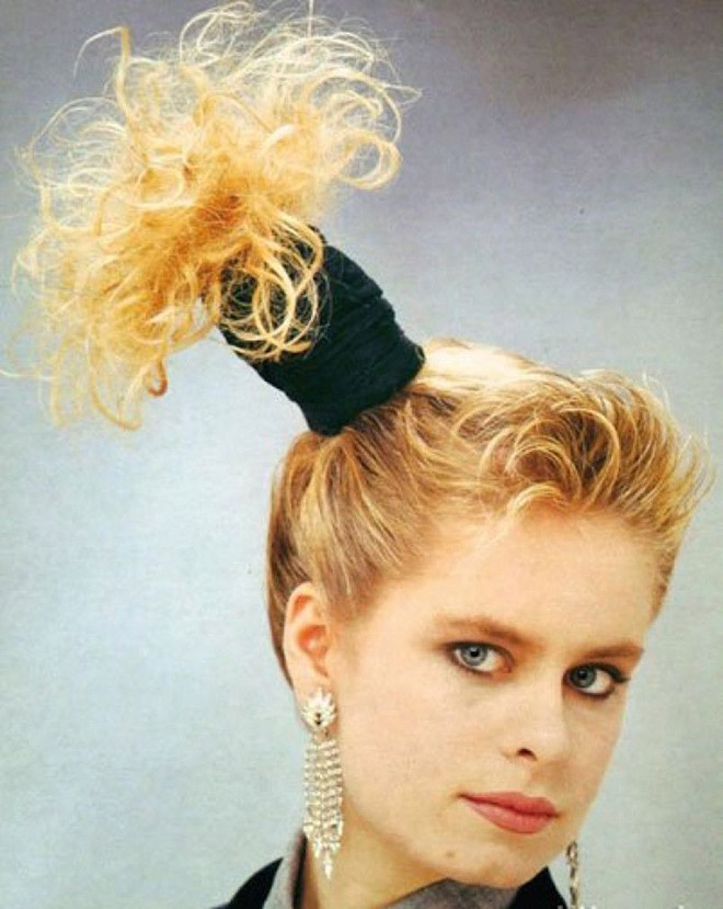 Awkward 1980s haircut.