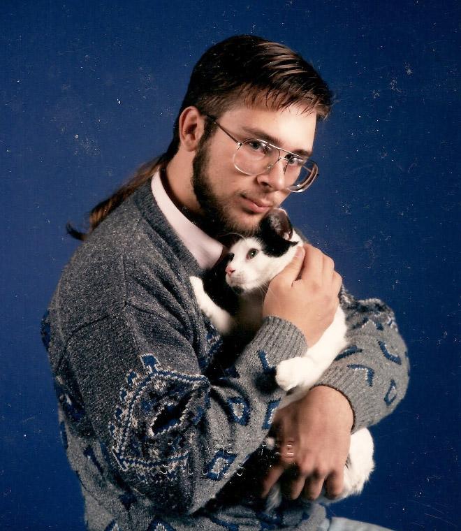 Funny awkward 1980s haircut.
