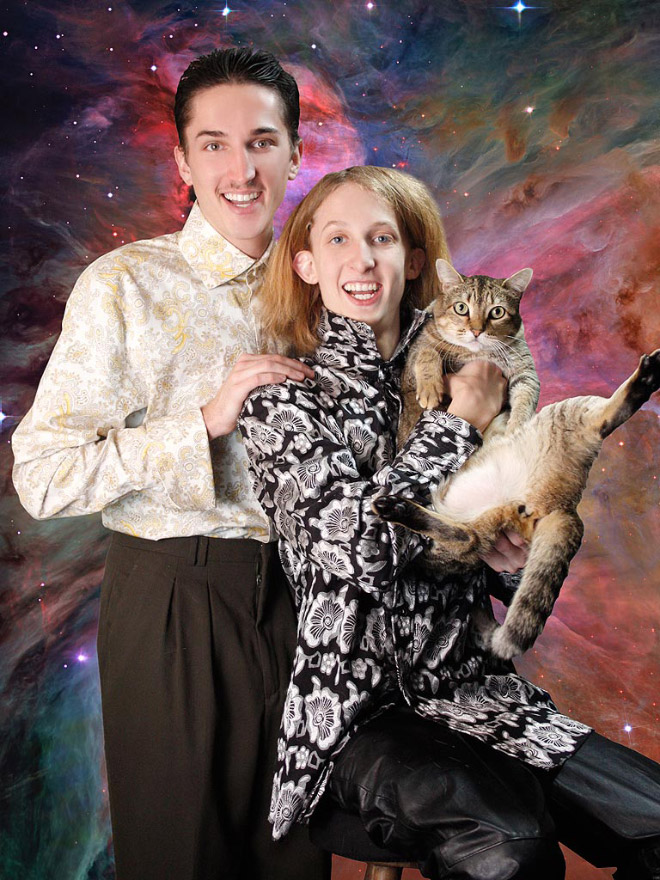 Lovely couple posing with a cat.