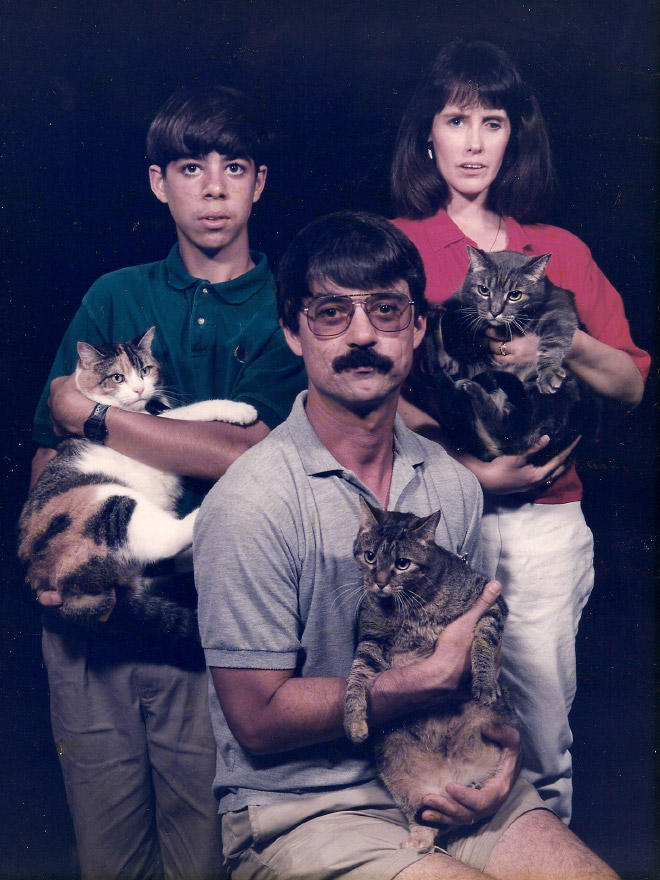 Awkward family photo with a cat.