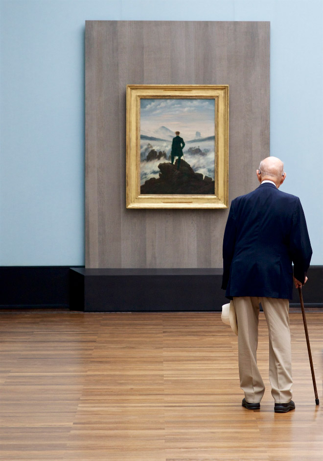 Old man accidentally matching a panting in a museum.