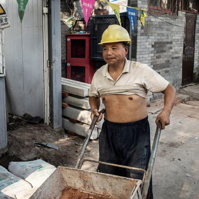 Chinese construction worker wearing the Beijing bikini.
