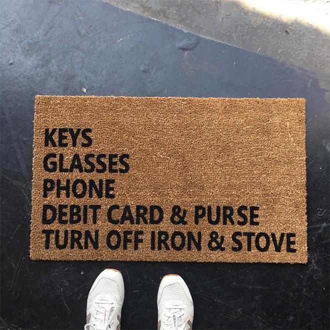 Clever doormat with reminders.