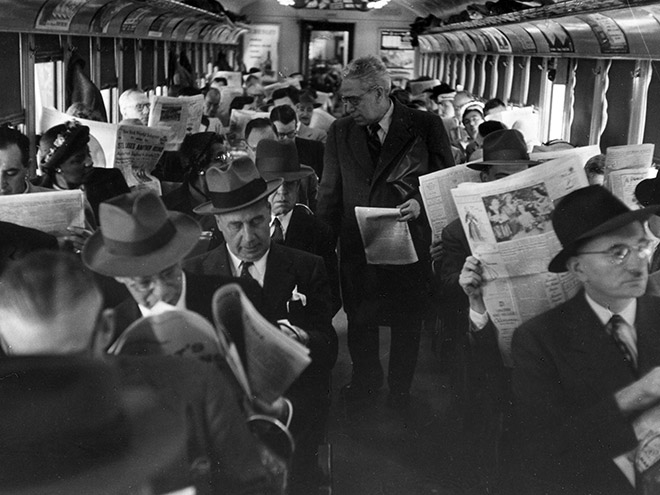 People reading newspapers.