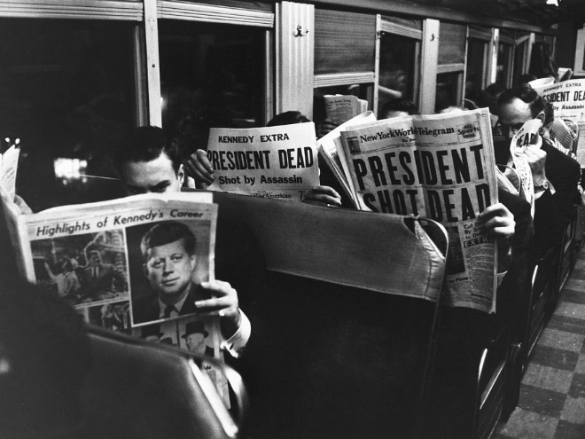 JFK assassination reported by newspapers.