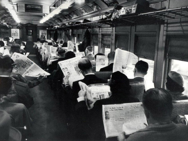People reading morning newspapers.
