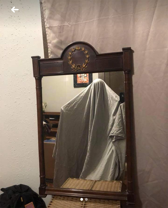Ghost selling a mirror.