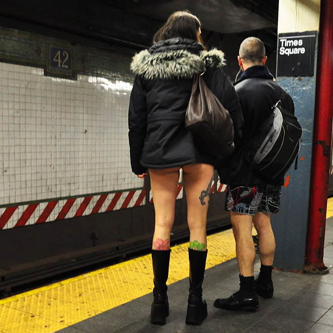 "Couple participating in ""No pants subway ride"" movement."