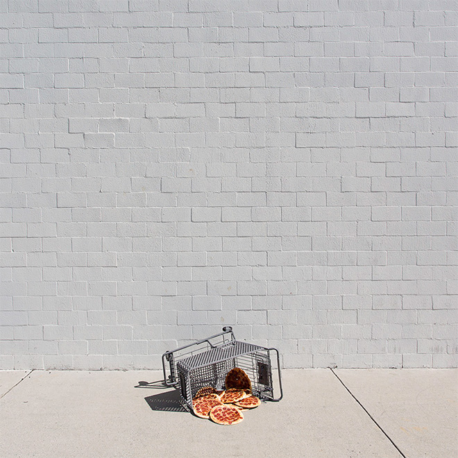 Someone forgot their pizzas in the shopping cart.