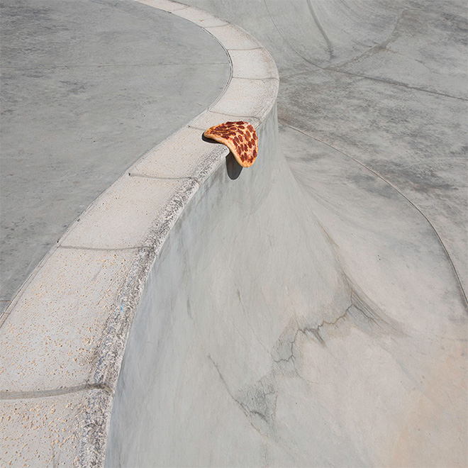 Lonely pizza in a skatepark.