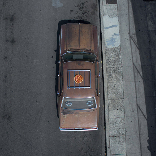 Pizza on a car's roof. Why? Because art.