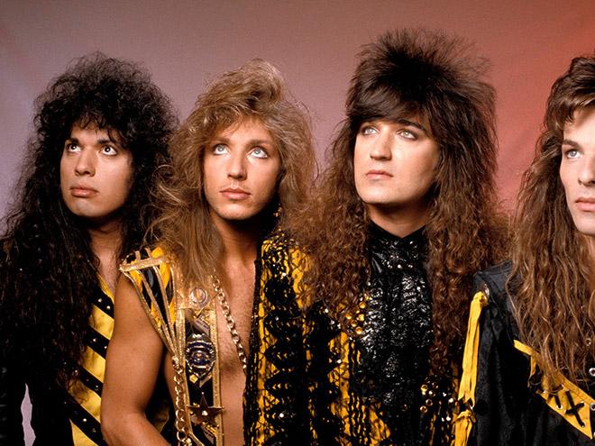 Funny 1980s metal band group photo.