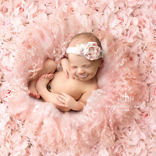 Baby with photoshopped smile.