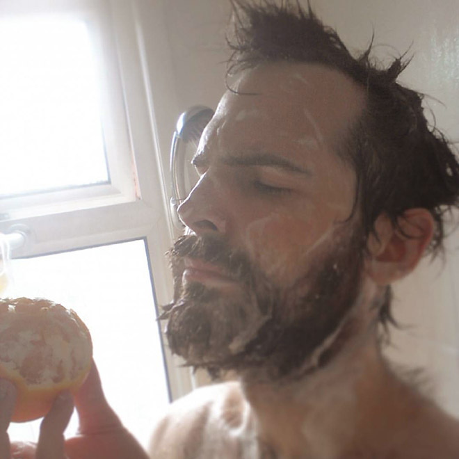Showering with oranges.