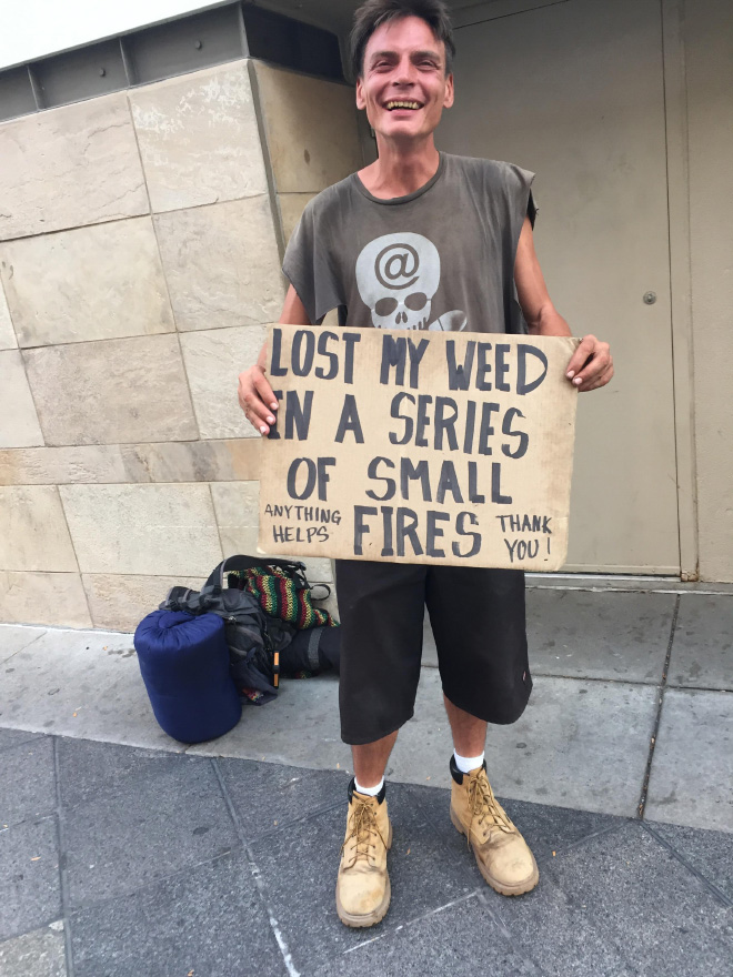 Funny panhandler sign.